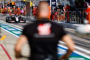 Romain Grosjean, Haas VF-20, in the pit lane