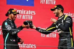 Podium: third place Daniel Ricciardo, Renault F1 Team, race winner Lewis Hamilton, Mercedes F1 celebrates with a shoey