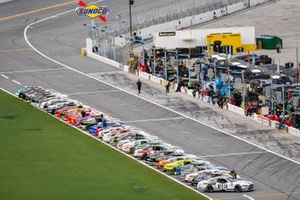 The full grid of Xfinity cars lined up along pit road before the Wawa 250 at Daytona International Speedway
