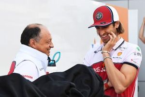 Frederic Vasseur, Team Principal, Alfa Romeo Racing, talks with Antonio Giovinazzi, Alfa Romeo Racing, in the paddock