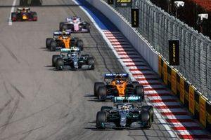 Lewis Hamilton, Mercedes AMG F1 W10, leads Carlos Sainz Jr., McLaren MCL34, Valtteri Bottas, Mercedes AMG W10, Lando Norris, McLaren MCL34, and Sergio Perez, Racing Point RP19