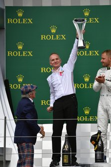 The Mercedes Constructors delegate lifts the trophy