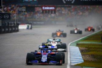 Alexander Albon, Toro Rosso STR14, leads Lewis Hamilton, Mercedes AMG F1 W10