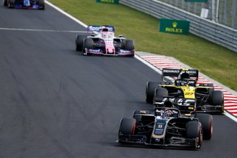 Romain Grosjean, Haas F1 Team VF-19, leads Nico Hulkenberg, Renault F1 Team R.S. 19, and Sergio Perez, Racing Point RP19