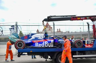 Marshals load the car of Daniil Kvyat, Toro Rosso STR14, onto a truck
