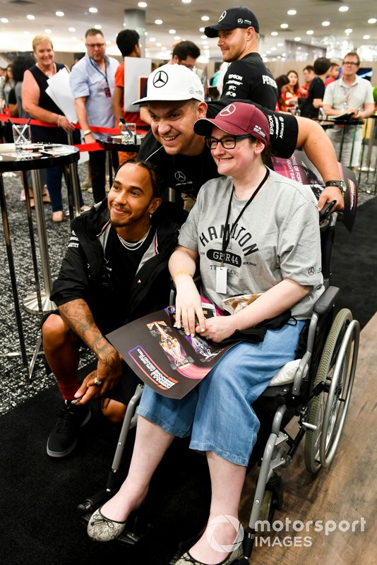 Lewis Hamilton, Mercedes AMG F1 poses for a photograph with a fan