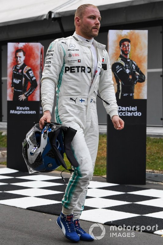 Valtteri Bottas, Mercedes AMG F1 arrive back into the paddock