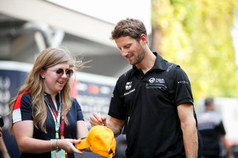 Romain Grosjean, Haas F1 Team signs an autograph for a fan