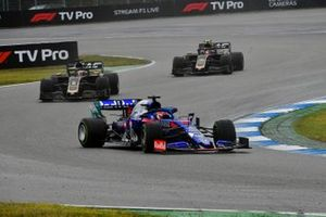 Daniil Kvyat, Toro Rosso STR14, leads Romain Grosjean, Haas F1 Team VF-19, and Kevin Magnussen, Haas F1 Team VF-19