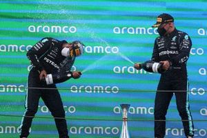 Lewis Hamilton, Mercedes, 1st position, and Valtteri Bottas, Mercedes, 3rd position, spray Champagne on the podium