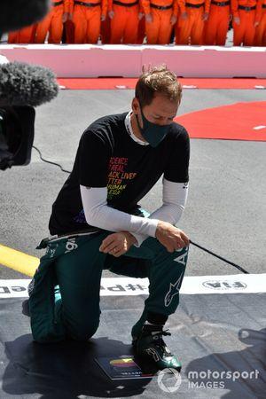 Sebastian Vettel, Aston Martin, takes aknee in support of the End Racsim campaign