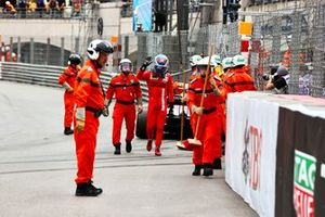 Marshals with Charles Leclerc, Ferrari, after his crash in Qualifying
