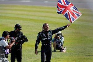 Lewis Hamilton, Mercedes, 1st position, flies the Union flag in celebration after the race