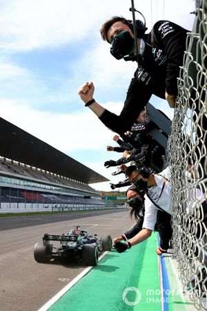 Lewis Hamilton, Mercedes W12, 1st position, takes victory to the delight of his team on the pit wall