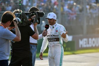 Lewis Hamilton, Mercedes AMG F1, is interviewed after securing pole