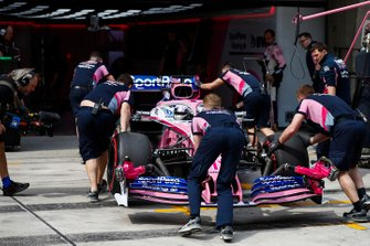 Sergio Perez, Racing Point RP19, is returned to the Racing Point garage