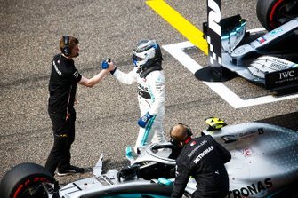 Pole man Valtteri Bottas, Mercedes AMG F1, celebrates with mechanics on the grid