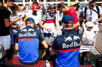 Alexander Albon, Toro Rosso and Daniil Kvyat, Toro Rosso sign an autographs for a fan