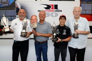 2020 Indy 500 winner Takuma Sato is presented with the Baby Borg-Warner Trophy by Fred Lissade, BorgWarner President and CEO. Team owners Bobby Rahal and Mike Lanigan also were presented with Baby Borg-Warner trophies. Team owner David Letterman was also honored with a facsimile of his face and Baby Borg-Warner trophy