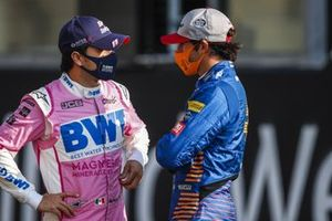 Sergio Perez, Racing Point, chats with Carlos Sainz Jr., McLaren