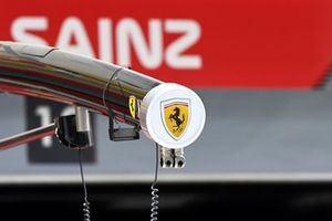 The Ferrari badge on the boom outside the pits