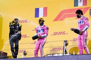 Esteban Ocon, Renault F1, 2nd position, Sergio Perez, Racing Point, 1st position, and Lance Stroll, Racing Point, 3rd position, on the podium
