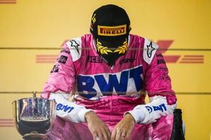 Sergio Perez, Racing Point, 1st position, contemplates on the podium