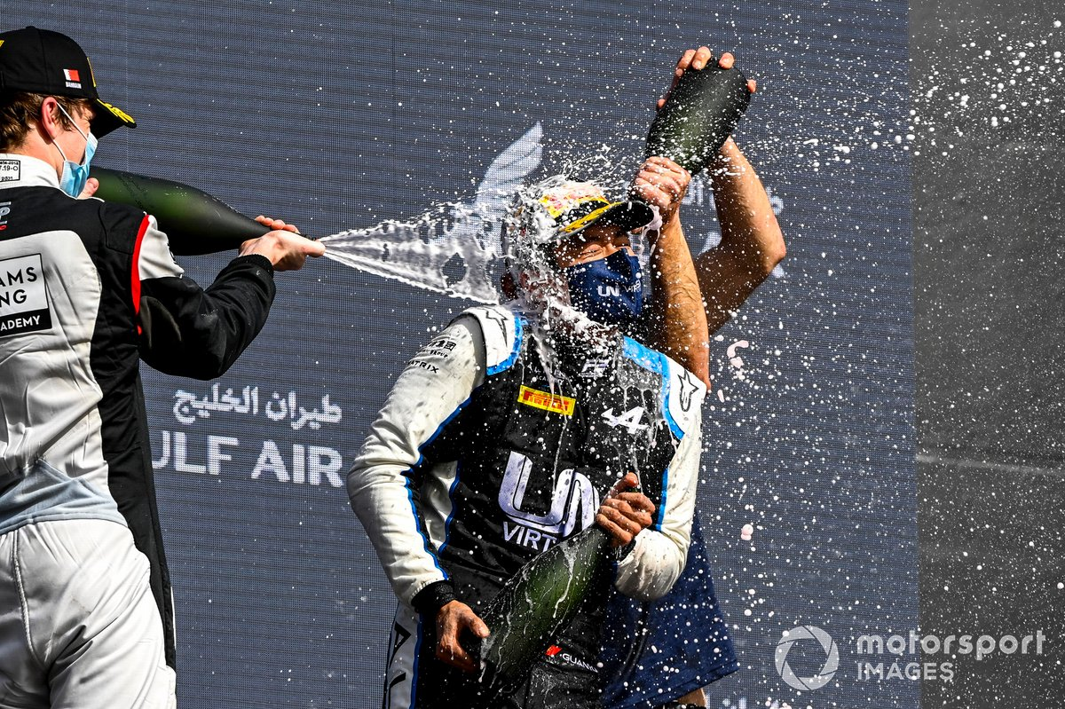 Dan Ticktum, Carlin and Race Winner Guanyu Zhou, Uni-Virtuosi Racing celebrate on the podium with the champagne