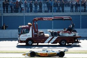 Winner Kenny Brack, Team Rahal passes the wreckage car of Alex Zanardi, Mo Nunn Racing
