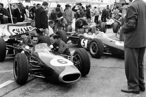 Jack Brabham, Brabham BT11 Climax and Dan Gurney, Brabham BT7 Climax wait in the pits