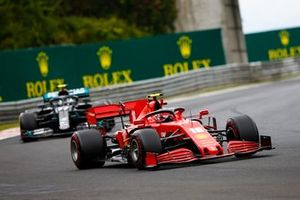 Charles Leclerc, Ferrari SF1000 and Valtteri Bottas, Mercedes F1 W11