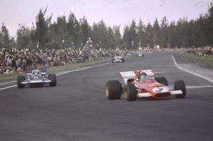 Jacky Ickx, Ferrari 312B heads Jackie Stewart, Tyrrell 001, Clay Regazzoni, Ferrari 312B