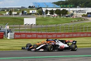 Romain Grosjean, Haas VF-20, battles with Carlos Sainz Jr., McLaren MCL35