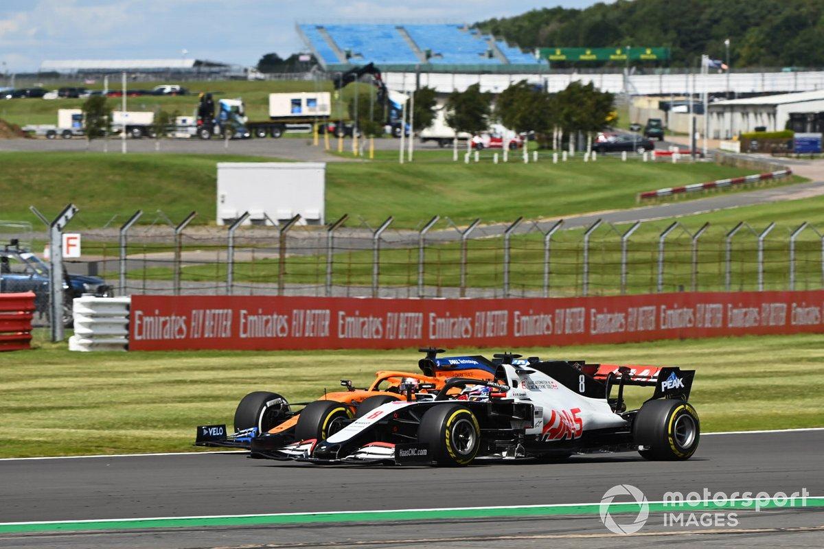 Romain Grosjean, Haas VF-20, Carlos Sainz Jr., McLaren MCL35
