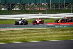 Mick Schumacher, Prema Racing, battles with Louis Deletraz, Charouz Racing System, ahead of Yuki Tsunoda, Carlin