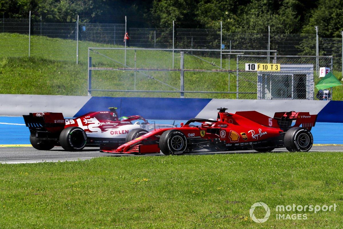 Sebastian Vettel, Ferrari fa un testacoda dopo un contatto con Carlos Sainz Jr., McLaren MCL35 mentre passa Antonio Giovinazzi, Alfa Romeo Racing C39