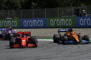 Charles Leclerc, Ferrari SF1000, battles with Carlos Sainz Jr., McLaren MCL35, ahead of Lance Stroll, Racing Point RP20