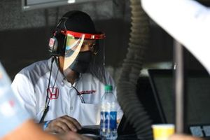 Honda crew member working on an Andretti Autosport car