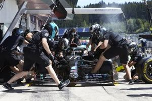 The Mercedes team practice pitstops in the pit lane