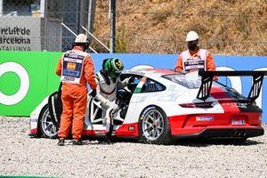 Michael Fassbender, Porsche Motorsport, climbs out of his damaged car after a crash at the start