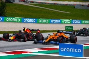Max Verstappen, Red Bull Racing RB16, battles Carlos Sainz Jr., McLaren MCL35