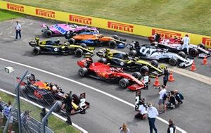 Max Verstappen, Red Bull Racing, 2nd position, Charles Leclerc, Ferrari, 3rd position, and other drivers park up in Parc Ferme