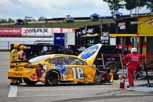 Kyle Busch, Joe Gibbs Racing, Toyota Camry pit stop after crash