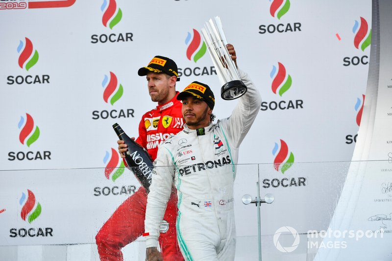 Lewis Hamilton, Mercedes AMG F1, 2nd position, leaves the podium with his trophy