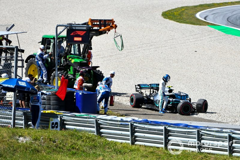 Valtteri Bottas, Mercedes AMG F1, climbs out of his damaged car after a crash in second practice
