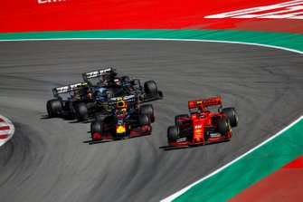 Charles Leclerc, Ferrari SF90, leads Pierre Gasly, Red Bull Racing RB15, Kevin Magnussen, Haas F1 Team VF-19, and Romain Grosjean, Haas F1 Team VF-19