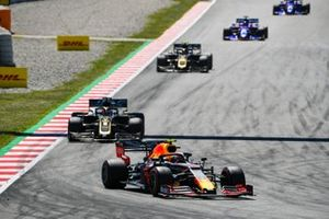 Pierre Gasly, Red Bull Racing RB15, leads Romain Grosjean, Haas F1 Team VF-19, and Kevin Magnussen, Haas F1 Team VF-19