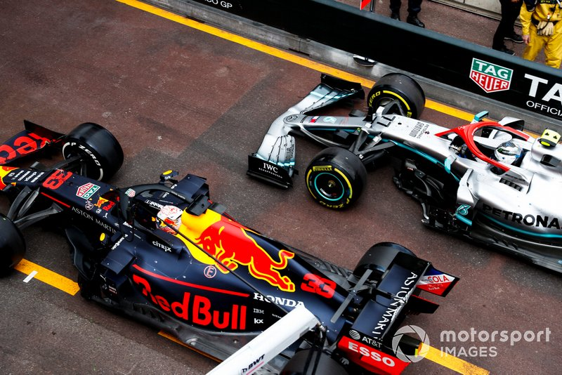 Max Verstappen, Red Bull Racing RB15, and Valtteri Bottas, Mercedes AMG W10, battle in the pit lane