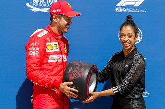Sebastian Vettel, Ferrari, is presented with his Pirelli Pole Position Award by actress Liza Koshy