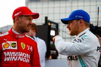 Sebastian Vettel, Ferrari, talks with pole man Valtteri Bottas, Mercedes AMG F1, after Qualifying